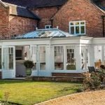Exterior of multi-section traditional timber orangery on listed home - by North Country's partner Totali