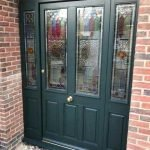 Stunning bespoke traditional door & side panels with beautiful coloured leaded lights in an original design - by North Country's partner Totali