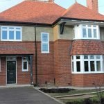 A whole house of high quality timber effect traditional flush style casement windows & timber doors.