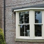 Sliding sash bay windows in this traditional style modern home