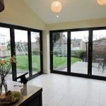 Internal view of a pair of Origin aluminium bifolding doors in Anthracite Grey - by North Country