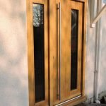 A beautiful contemporary style full boarded Accoya entrance door with side panels, stained in light oak