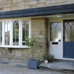 Accoya wood flush casements & entrance door with Gothic glazing bars - by North Country's partner Totali